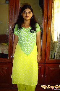 Neha bhabhi in green and yellow Indian shalwar suit