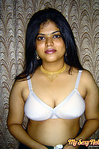 Gorgeous Neha Nair in white bra giving seductive poses and playing with bigtits