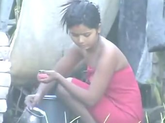 young sexy indian girl taking open air shower recorded