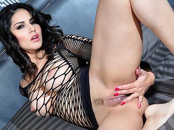 Beautiful Sunny Leone touches herself all over